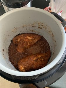 Pressure cooker with burned chicken
