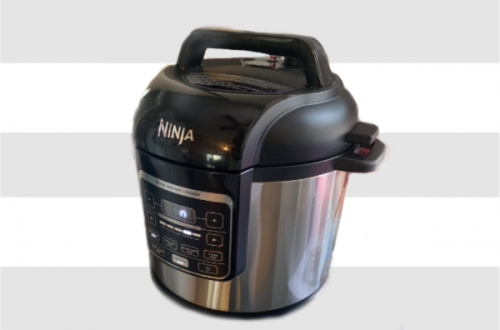 ninja pressure cooker on gray and white striped background